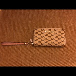 Michael Kors with pink wristband.  New wallet
